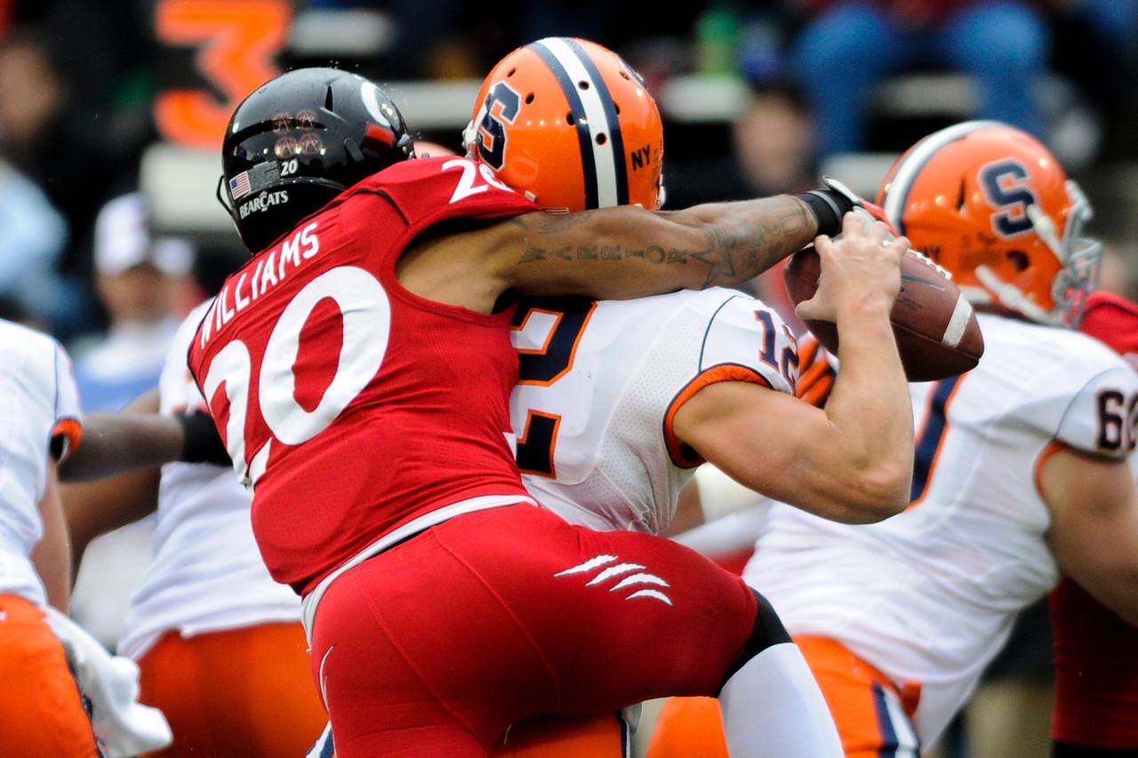 Cincinnati Bearcats defensive back Chris Williams (20) sacks Syracuse Orange quarterback Ryan Nassib (12) during the game.  Cincinnati Bearcats defeated Syracuse Orange (35-24) at Nippert Stadium in Cincinnati, Ohio.