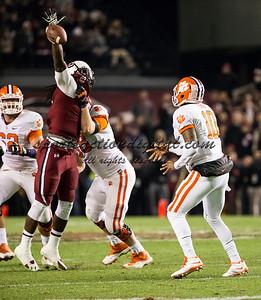 South Carolina Gamecocks defensive end Jadeveon Clowney (7), Clemson Tigers quarterback Tajh Boyd (10)