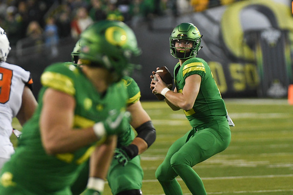 Oregon quarterback Justin Herbert prepares to throw a touchdown pass to tight end Jacob Breeland Saturday in the Ducks' Civil War win over Oregon State.