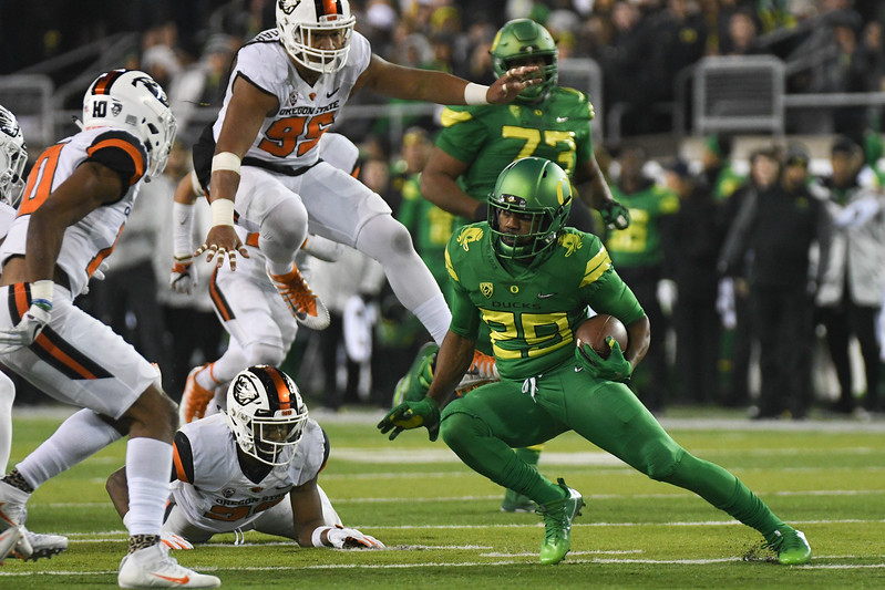 Oregon running back Kani Benoit runs the ball during the Ducks' big Civil War win Saturday over Oregon State.
