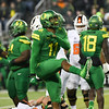 Oregon defender Justin Hollins celebrates a play in the first half of the Ducks' blowout Civil War win Saturday over Oregon State at Autzen Stadium.