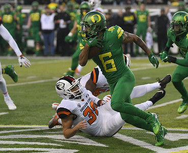 Oregon running back Charles Nelson runs the ball in the first half of the Ducks' blowout win over Oregon State in the Civil War rivalry game.