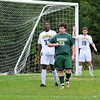 DSC_7119. Will McNally(33) is defended by Ogigna Walters (32) and Andrew Stott(15) for an incoming corner kick.