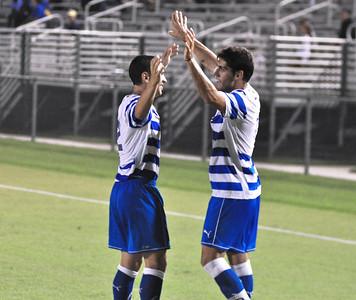 Gimenez and Ellis celebrate after a goal scored by Gimenez