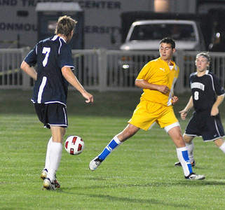 Vincent Mediate clears a ball at midfield