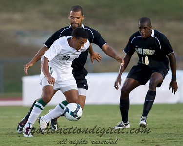 Evan James (Charlotte) shields the ball against Wake Forest's Sam Redmond