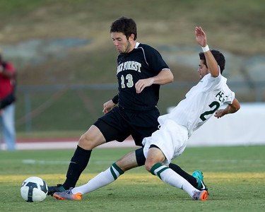 Anthony Perez of Charlotte challenges Wake Forest's Ben Newman