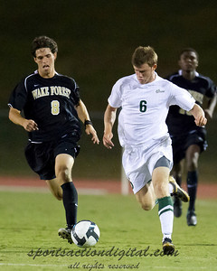 Will Mayhew (Charlotte) a recent transfer from Wake Forest contests the ball against former teammate Luciano Delbono