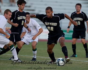 Wake Forest's Sam Redmond comes out with the ball in a crowd