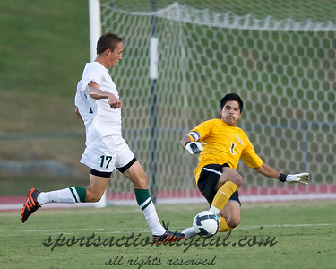Jennings Rex of Charlotte goes in hard for the ball and is challenged by Wake Forest keeper Akira Fitzgerald