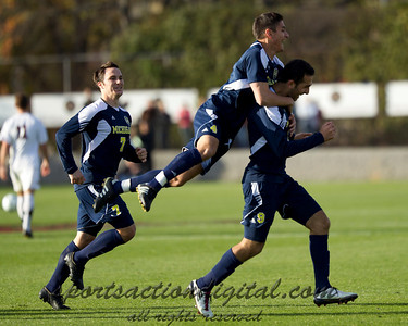 Dylan Mencia (4) jumps on the back of Justin Meram (9) after he scores.