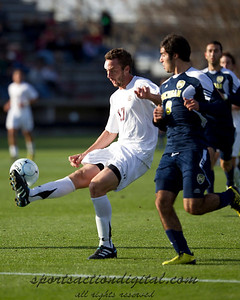 Will Traynor (17) controls the ball while being defended by Soony Saad (8)