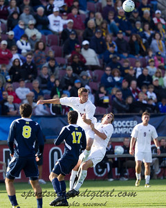 Evan O'dell (18) goes up for the ball and takes out his own player Stephen Morrissey (5) as Michigan's Harmoody Saad (17) looks on.
