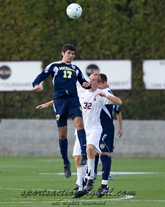 Hamoody Saad (17) of Michigan heads the ball while Danny Cates defends