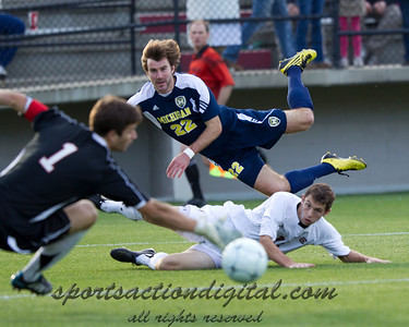 Matt Schmitt (22) fires wide as Carolina goalkeeper Jimmy Maurer dives to save