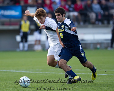 Mike Magnotic (4) of Carolina defends Michigan's Soony Saad