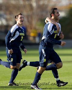 Justin Meram (9) celebrates his goal with Chase Tennant (7)
