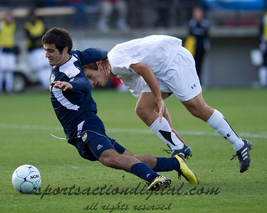 Soony Saad of Michigan earns a yellow card for diving