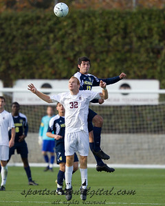 Hamoody Saad (17) goes up over Danny Cates (32) for a header