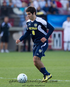Soony Saad of Michigan advances the ball