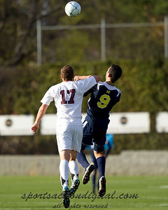 Justin Meram (9) and Will Traynor (17) go up for a header.  Traynor's elbow to the head of Meram resulted in a red card.
