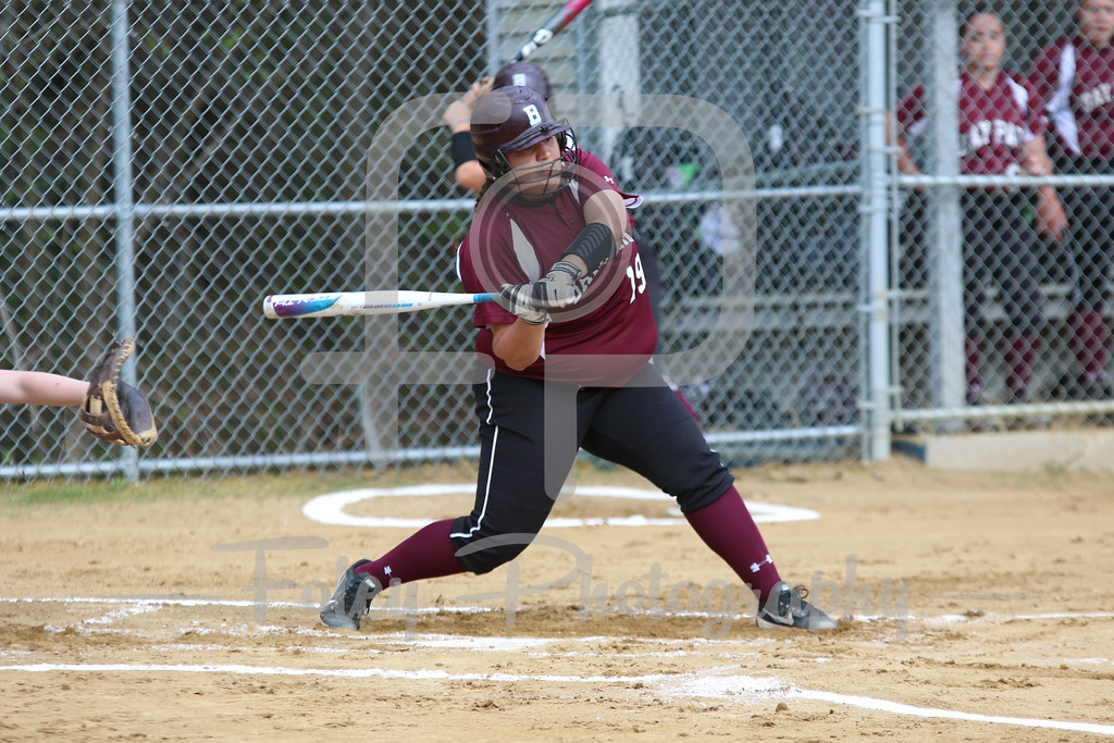 Bay Path WIldcats catcher Lilly West (19)