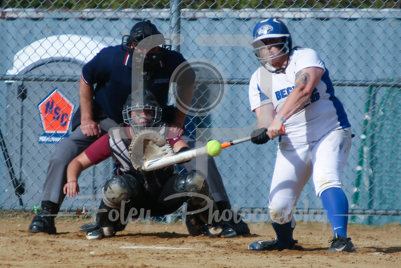 Becker College Hawks first baseman Ashley Ciepiela (25) Bay Path WIldcats pitcher Madison Goodhart (64)