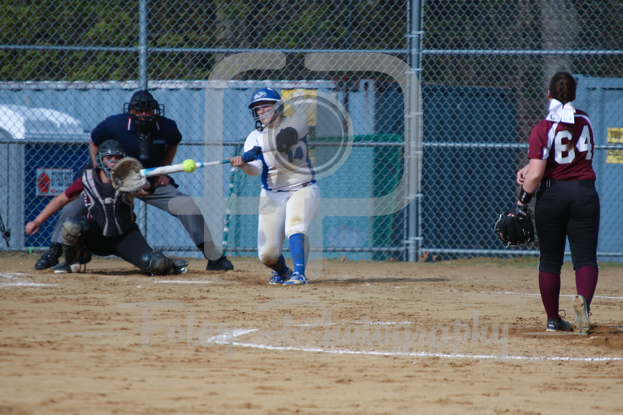 Becker College Hawks catcher Megan Klemanchuck (14) Bay Path WIldcats pitcher Madison Goodhart (64)