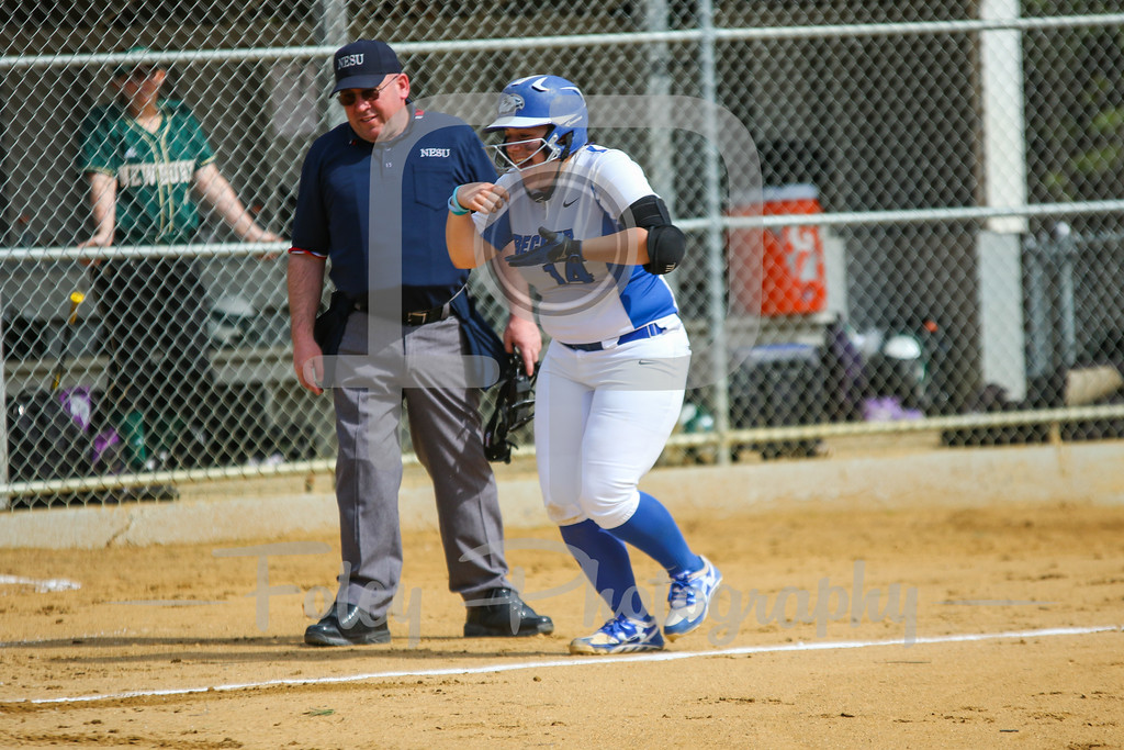 Monday, April 10, 2017; Leicester, MA; Becker College Hawks catcher Megan Klemanchuck (14) heads home after her first inning home run during the Nighthawks 4-3 victory over the Hawks in Game 1 of a NECC doubleheader.