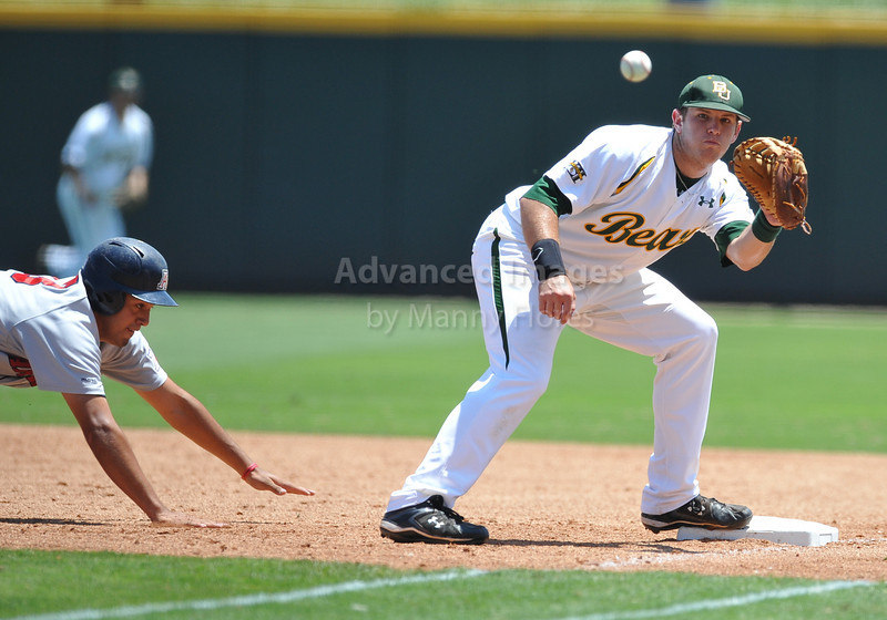4th June 2010:  <br /> Baylor First Baseman Max Muncy #9 gets the ball and looks to tag runner at the 2010 College World Series Fort Worth Regional game<br /> between the Baylor Bears and the Arizona Wildcats at Lupton Stadium in Fort Worth, Texas.<br /> Arizona wins 5-3