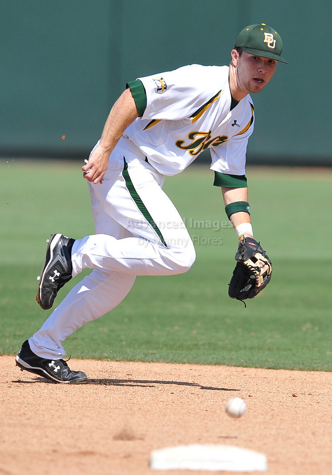 4th June 2010:  <br /> Baylor Shortstop Landis Ware #5 tries to get a line drive<br /> at the 2010 College World Series Fort Worth Regional game<br /> between the Baylor Bears and the Arizona Wildcats at Lupton Stadium in Fort Worth, Texas.<br /> Arizona wins 5-3