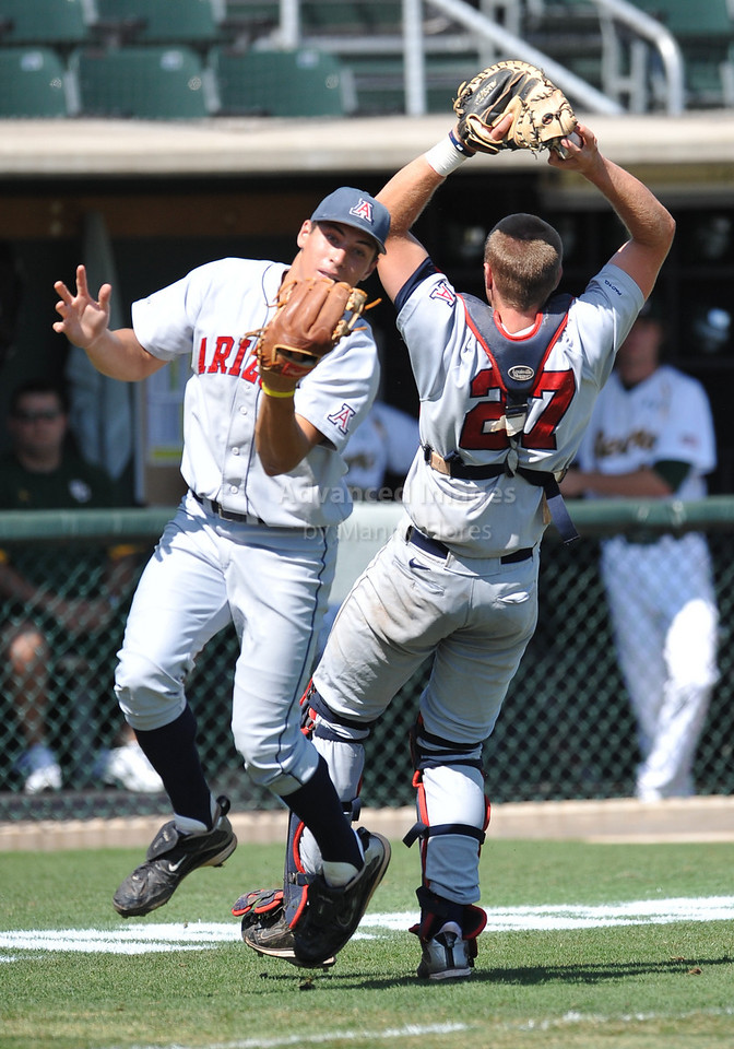4th June 2010:  <br /> Arizona Catcher Jett Bandy #27 gets a fly ball while teammate Seth Mejias-Brean runs into him at the 2010 College World Series Fort Worth Regional game between the Baylor Bears and the Arizona Wildcats at Lupton Stadium in Fort Worth, Texas.<br /> Arizona wins 5-3
