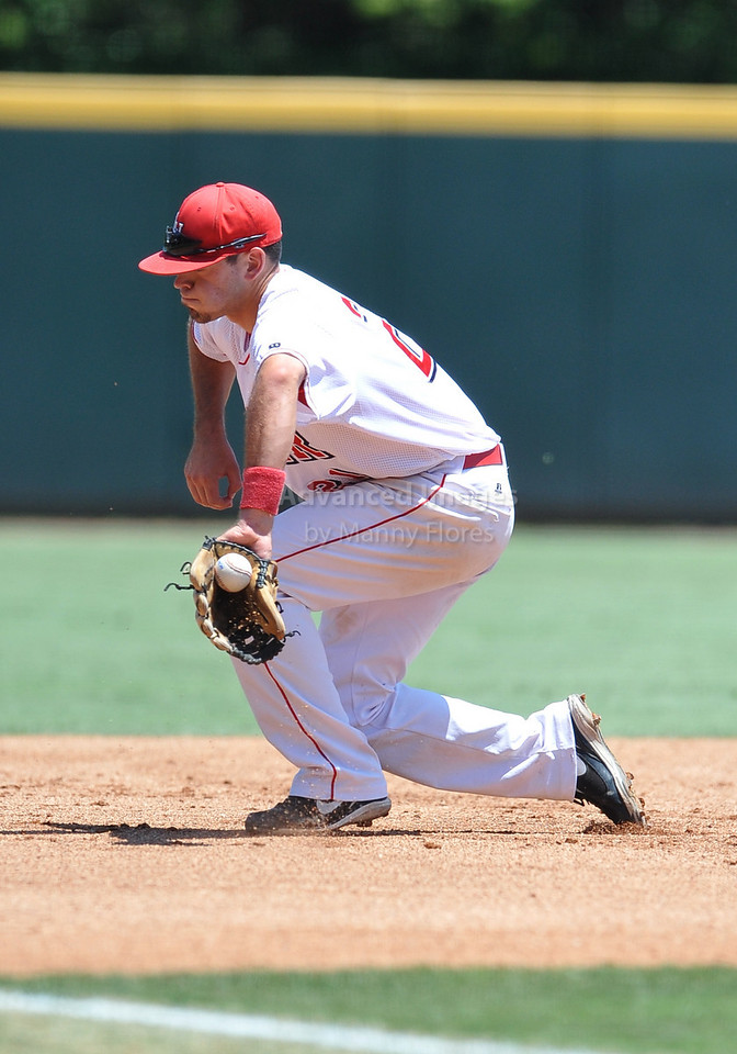 5th June 2010:  <br /> Lamar Third Baseman Andy Mena #21fields a ground ball<br /> at the 2010 NCAA Fort Worth Regional game between the Baylor Bears and the Lamar Cardinals at Lupton Stadium in Fort Worth, Texas.<br /> Baylor wins 6-4