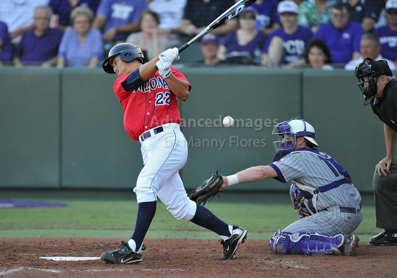 5th June 2010:  <br /> Arizona LF Robert Refsnyder #22 foul tips the ball <br /> during the 2010 NCAA Fort Worth Baseball Regional game<br /> between the TCU Horned Frogs and the Arizona Wildcats at Lupton Stadium in Fort Worth, Texas.<br /> TCU wins 11-5