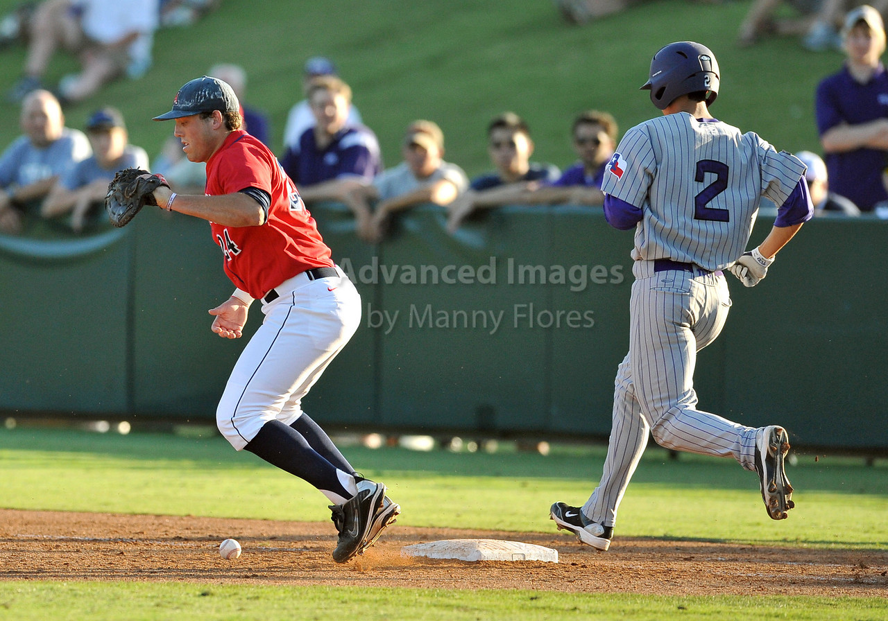 5th June 2010:  <br /> Arizona 1st Baseman Cole Frenzel #24 drops the ball on what would have been a sure out during the 2010 NCAA Fort Worth Baseball Regional game between the TCU Horned Frogs and the Arizona Wildcats at Lupton Stadium in Fort Worth, Texas.<br /> TCU wins 11-5