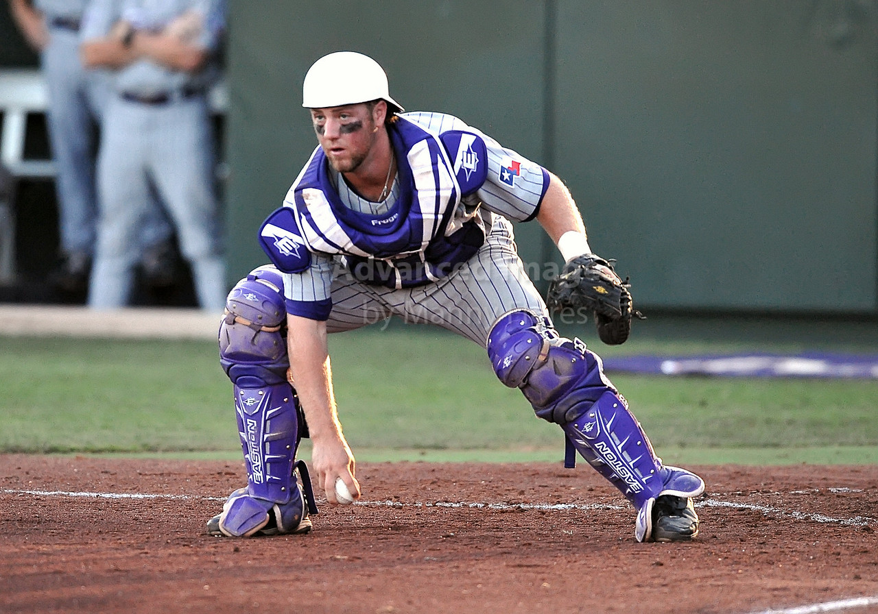 5th June 2010:  <br /> TCU Catcher Bryan Holaday #16 picks up a loose ball and holds the runner at 3rd base during the 2010 NCAA Fort Worth Baseball Regional game between the TCU Horned Frogs and the Arizona Wildcats at Lupton Stadium in Fort Worth, Texas.<br /> TCU wins 11-5