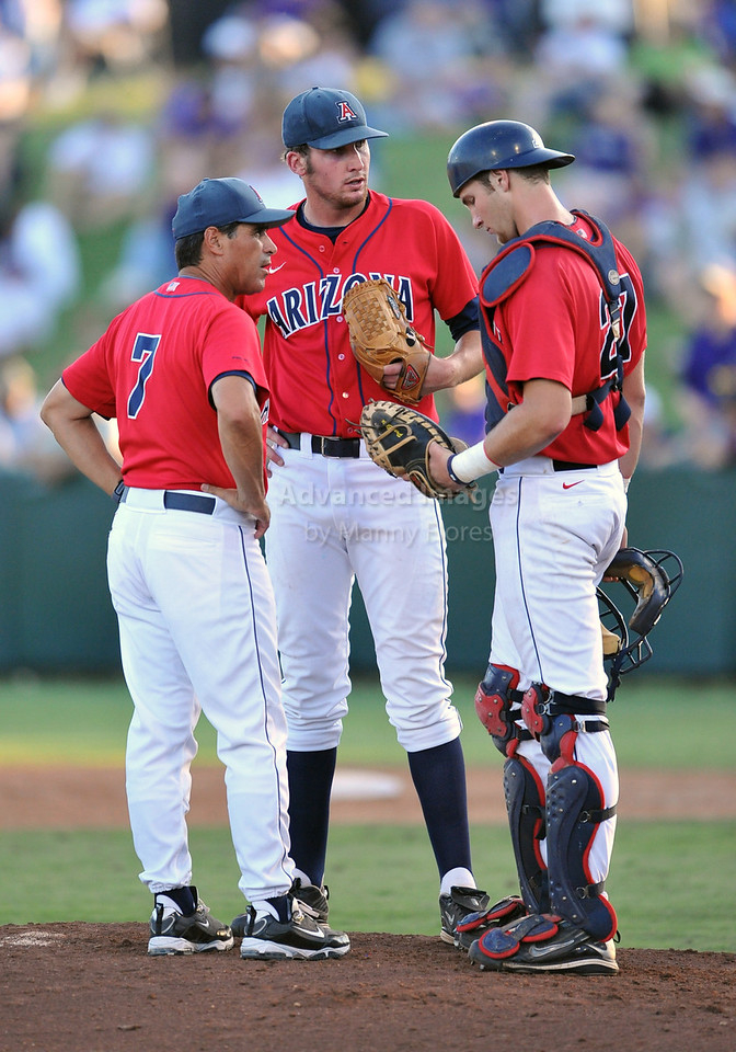 5th June 2010:  <br /> Arizona Pitcher Kyle Simon #18, Catcher Jett Bandy #27 and Arizona Head Coach Andy Lopez try to calm things down<br /> during the 2010 NCAA Fort Worth Baseball Regional game<br /> between the TCU Horned Frogs and the Arizona Wildcats at Lupton Stadium in Fort Worth, Texas.<br /> TCU wins 11-5
