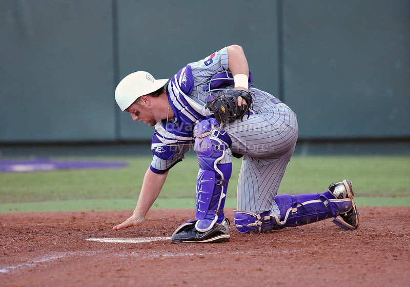 5th June 2010:  <br /> TCU Catcher Bryan Holaday #16 clears home plate<br /> during the 2010 NCAA Fort Worth Baseball Regional game<br /> between the TCU Horned Frogs and the Arizona Wildcats at Lupton Stadium in Fort Worth, Texas.<br /> TCU wins 11-5