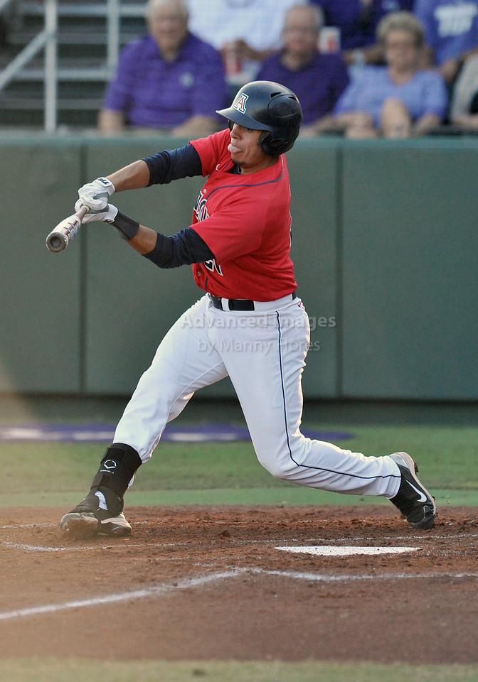 5th June 2010:  <br /> Arizona 2b Rafael Valenzuela #21 fights off a pitch<br /> during the 2010 NCAA Fort Worth Baseball Regional game<br /> between the TCU Horned Frogs and the Arizona Wildcats at Lupton Stadium in Fort Worth, Texas.<br /> TCU wins 11-5
