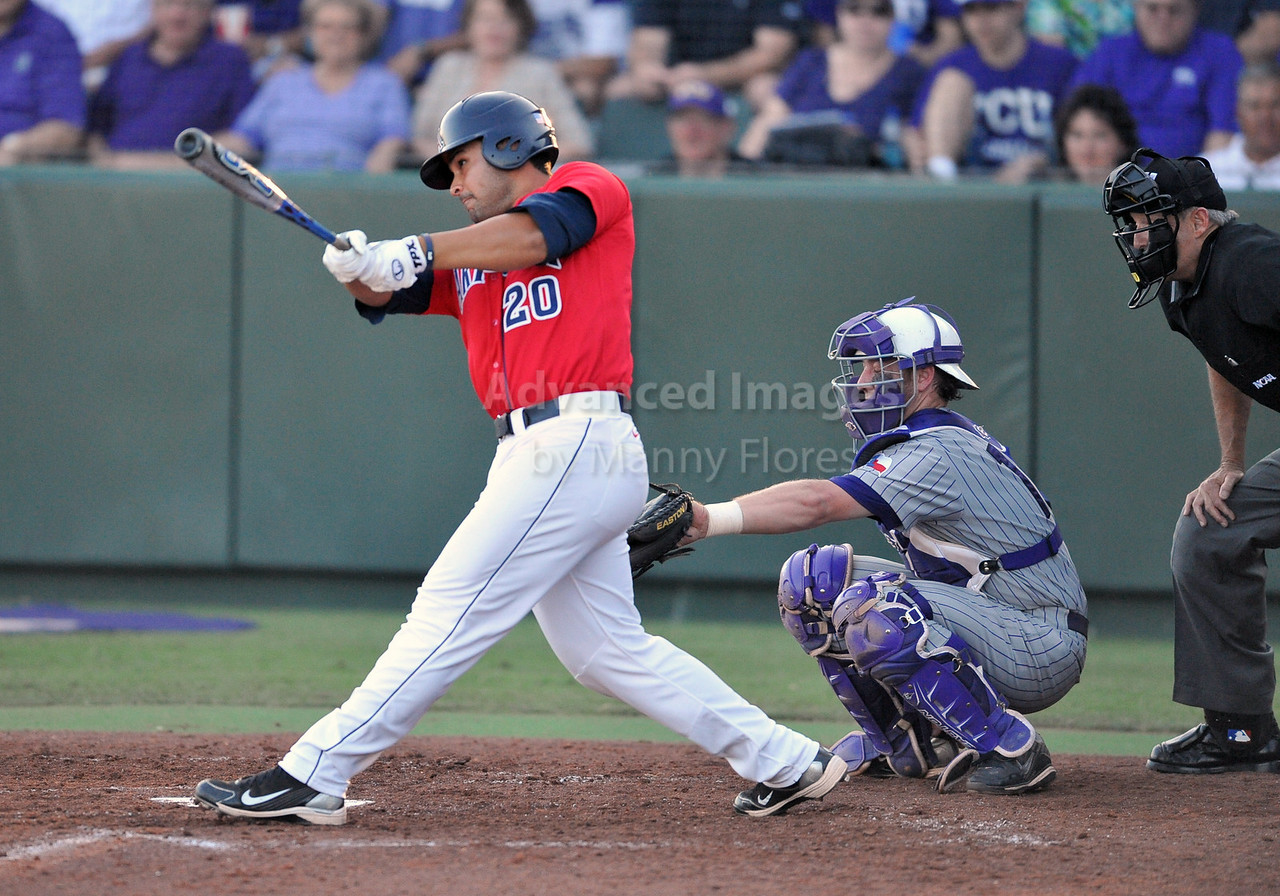 5th June 2010:  <br /> Arizona dh Josh Garcia #20 gets a base hit<br /> during the 2010 NCAA Fort Worth Baseball Regional game<br /> between the TCU Horned Frogs and the Arizona Wildcats at Lupton Stadium in Fort Worth, Texas.<br /> TCU wins 11-5