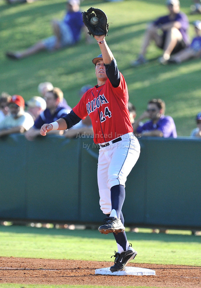 5th June 2010:  <br /> Arizona 1st Baseman Cole Frenzel #24 reaches high to save a pass ball and gets the out  the 2010 NCAA Fort Worth Baseball Regional game between the TCU Horned Frogs and the Arizona Wildcats at Lupton Stadium in Fort Worth, Texas.<br /> TCU wins 11-5