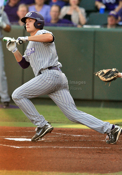 5th June 2010:  <br /> TCU Catcher Jimmie Pharr #31 bunts his way on to 1st base<br /> during the 2010 NCAA Fort Worth Baseball Regional game<br /> between the TCU Horned Frogs and the Arizona Wildcats at Lupton Stadium in Fort Worth, Texas.<br /> TCU wins 11-5