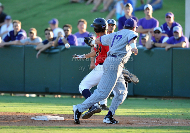 5th June 2010:  <br /> TCU 1B Matt Curry #17 tries to tag the runner out <br /> during the 2010 NCAA Fort Worth Baseball Regional game<br /> between the TCU Horned Frogs and the Arizona Wildcats at Lupton Stadium in Fort Worth, Texas.<br /> TCU wins 11-5