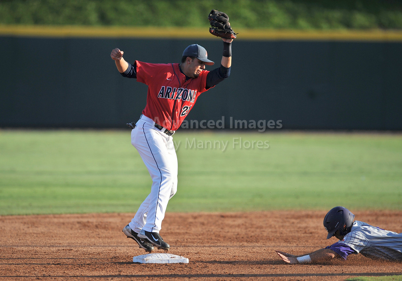 5th June 2010:  <br /> Arizona 2b Rafael Valenzuela #21 tries to get the runner out at second<br /> during the 2010 NCAA Fort Worth Baseball Regional game<br /> between the TCU Horned Frogs and the Arizona Wildcats at Lupton Stadium in Fort Worth, Texas.<br /> TCU wins 11-5