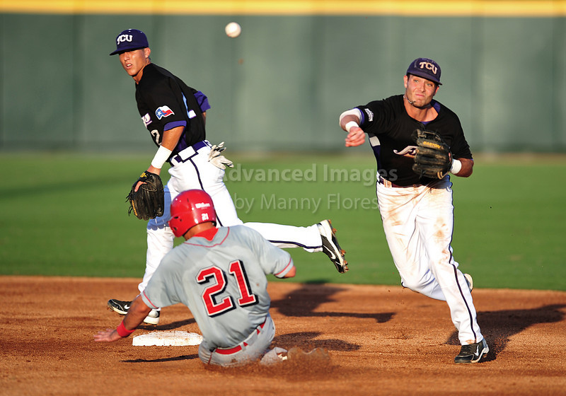 4th June 2010:  <br /> TCU SS Taylor Featherston #12 gets a double play<br /> at the 2010 College World Series Fort Worth Regional game<br /> between the TCU Horned Frogs and the Lamar Cardinals at Lupton Stadium in Fort Worth, Texas.<br /> TCU wins 16-3