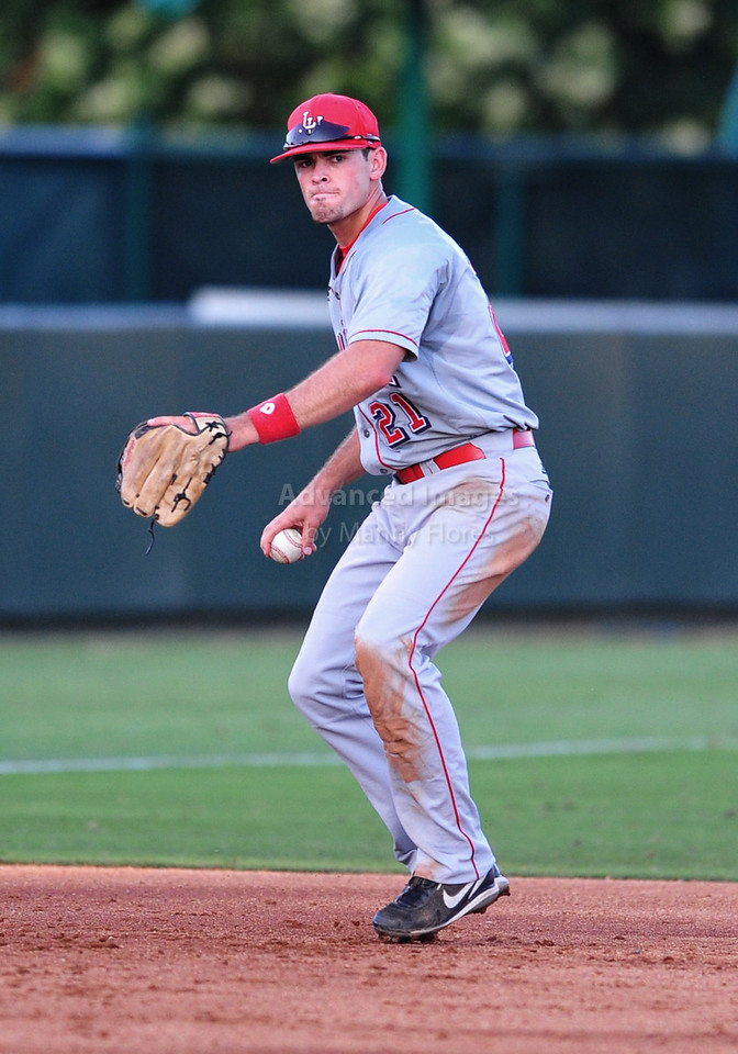 4th June 2010:  <br /> Lamar Third Baseman Andy Mena #21 throws the ball to 1st base<br /> at the 2010 College World Series Fort Worth Regional game<br /> between the TCU Horned Frogs and the Lamar Cardinals at Lupton Stadium in Fort Worth, Texas.<br /> TCU wins 16-3