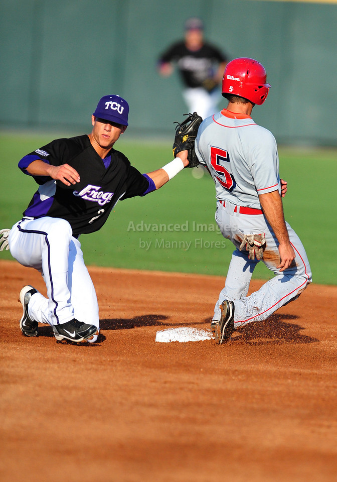 4th June 2010:<br /> TCU Second Base Jerome Pena #2 tags runner out<br /> at the 2010 College World Series Fort Worth Regional game<br /> between the TCU Horned Frogs and the Lamar Cardinals at Lupton Stadium in Fort Worth, Texas.<br /> TCU wins 16-3