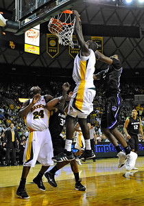 Jan 26th, 2010:   Baylor Quincy Acy #4 F gets a dunk in a NCAA basketball game between the Kansas State Wildcats and the Baylor Bears at the Ferrell Coliseum in Waco, Texas. Kansas State wins 76-74
