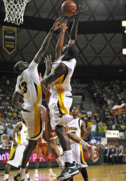 March 6th, 2010:  <br /> Baylor Bears Ekpe Udoh #13 F/C and Baylor Bears Quincy Acy #4 Forward gets a block in a NCAA basketball game between the Texas Longhorns and the Baylor Bears at the Ferrell Coliseum in Waco, Texas.<br /> Baylor wins 92-77
