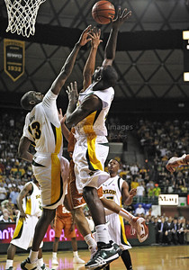 March 6th, 2010:   Baylor Bears Ekpe Udoh #13 F/C and Baylor Bears Quincy Acy #4 Forward gets a block in a NCAA basketball game between the Texas Longhorns and the Baylor Bears at the Ferrell Coliseum in Waco, Texas. Baylor wins 92-77